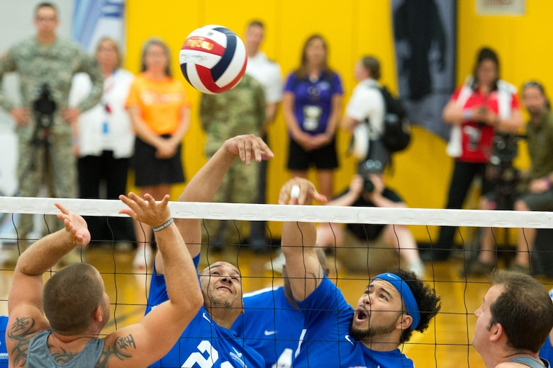 Air Force Tech. Sgt. Brian Williams, left, and Air Force veteran Staff Sgt. Sven Perryman return a volley during the sitting volleyball gold medal round in the 2016 Department of Defense Warrior Games at the U.S. Military Academy in West Point, N.Y., June 21, 2016. (DOD photo/EJ Hersom)