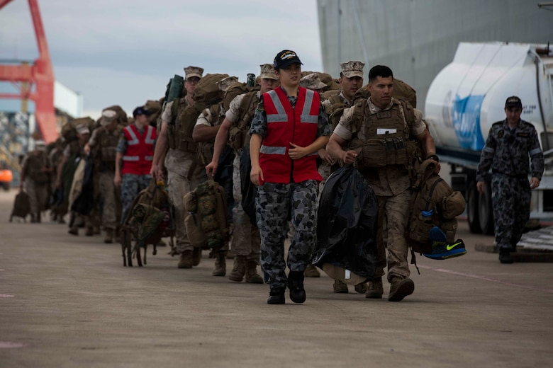 U.S. Marines prepare to go aboard the HMAS Adelaide at Port of Brisbane, Queensland, Australia, June 16, 2016. This marks the first time Marines and sailors from Marine Rotational Force - Darwin have embarked in such numbers on an Australian HMAS. This opportunity allows for MRF-D to expand the partnership capabilities with our Australian allies. The Marines are with 1st Battalion, 1st Marine Regiment, MRF-D, and the Australians are with HMAS Adelaide.