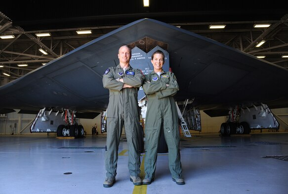 U.S. Air Force Lt. Col. Robert Makros, the 13th Bomb Squadron commander, and Lt. Col. Beth Makros, the 509th Operations Group deputy commander, pose with a B-2 Spirit at Whiteman Air Force Base, Mo., June 7, 2016. The Makros are one of only three married couples to ever both fly the B-2. (U.S. Air Force photo by Airman 1st Class Michaela R. Slanchik)