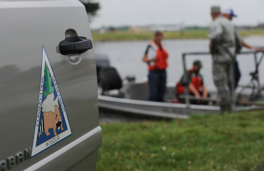 Members of the 509th Civil Engineer Squadron and Missouri Department of Conservation prepare to inspect fish samples they collected from Ike Skelton Lake using electrofishing at Whiteman Air Force Base, Mo., June 21, 2016. Electrofishing uses two electrodes, a cathode and an anode, which draw the fish closer to the boat, making it easier for them to be caught by a net. (U.S. Air Force photo by Senior Airman Danielle Quilla)