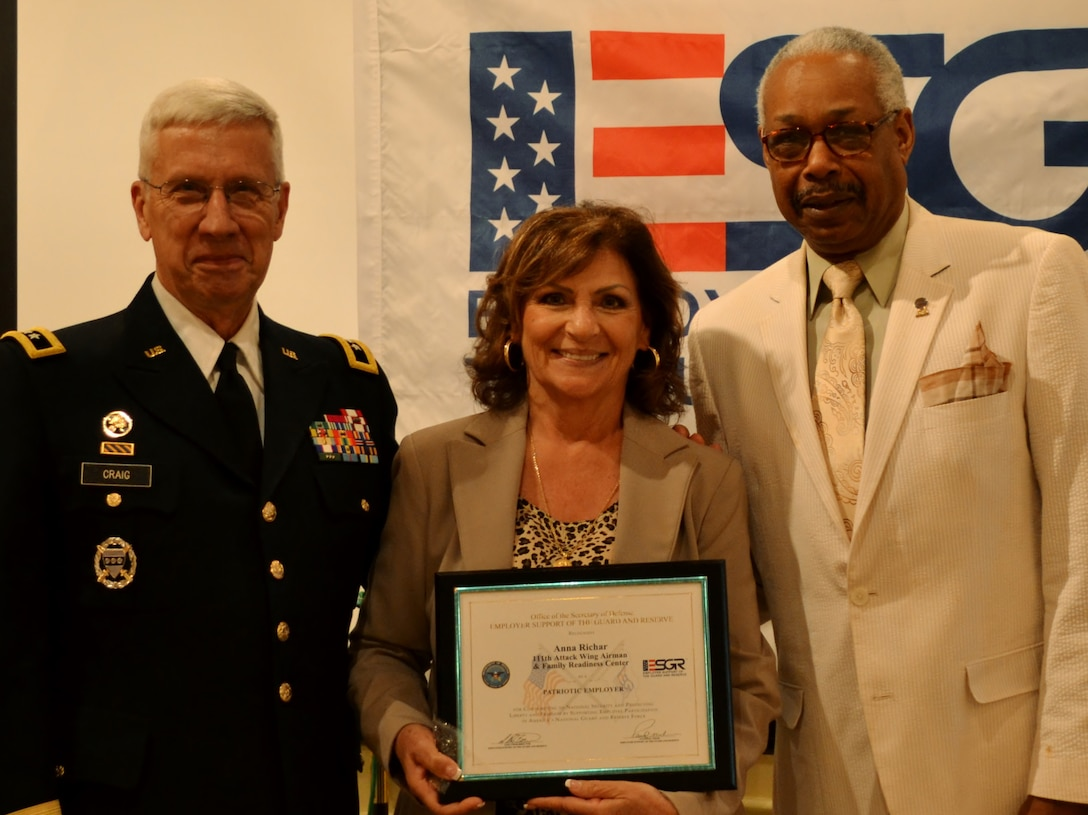 Former The Adjutant General—Pennsylvania retired Maj. Gen. Wesley Craig, Jr., and Southeast Area Chairman for the Pennsylvania Employer Support of the Guard Reserve Albert Newman, present a recognition award to Anna Richar, the Horsham Air Guard Station Airman & Family Readiness Center program manager, during an ESGR recognition and awards banquet held in Horsham, Pa., June 14, 2016. Craig served as the keynote speaker and was the 51st adjutant general for the state. (U.S. Air National Guard photo by Tech. Sgt. Andria Allmond)
