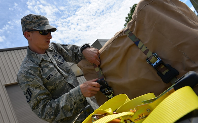 Staff Sgt. Joshua Buco, 157th Civil Engineering Squadron emergency management craftsman, secures items needed to set-up the FORTS (Fold-Out Rigid Temporary Shelters) structure at Pease Air National Guard Base, N.H., June 17.  The FORTS structure can be set up in less than 10 minutes, and are designed to withstand wind loads of over 100mph. (U.S. Air National Guard photo by Tech. Sgt. Erica Rowe)