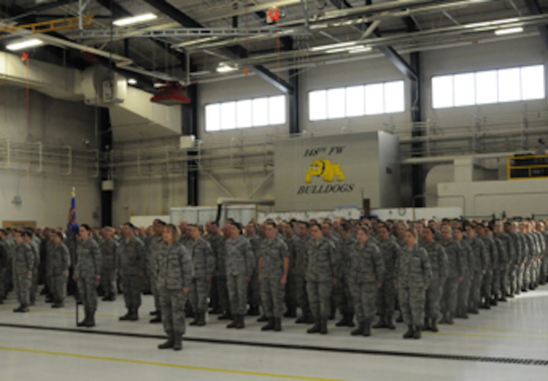 The 148th Fighter Wing assembles for a change of command ceremony.