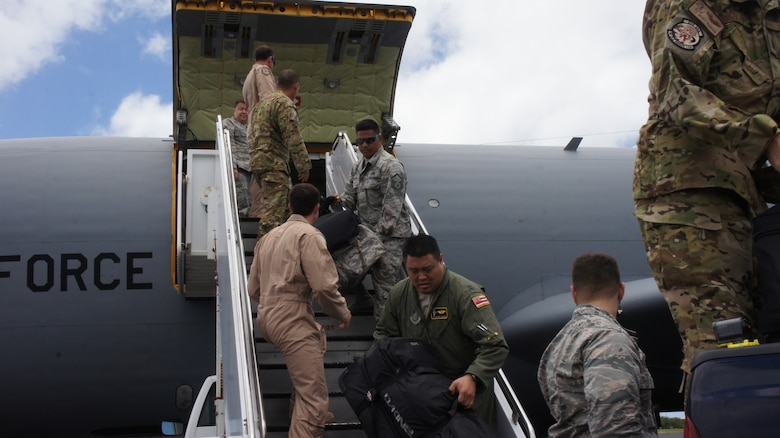 Airmen from the Hawaii Air National Guard's 203rd Air Refueling Squadron offload cargo from a KC-135 Stratotanker, Jun. 20, 2016, Joint Base Pearl Harbor-Hickam. More than 50 members of the Hawaii Air National Guard and three KC-135 aircraft returned home following a four month deployment in support of Operation Inherent Resolve. The flight crews and aircraft from the 203rd ARS along with maintenance and other support personnel from the 154th Wing were part of the 18-Nation air Coalition in the fight against Daesh or ISIS. (U.S. Air National Guard photo by Tech. Sgt. Andrew Jackson/released)