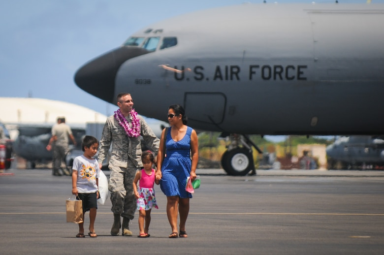 An airman from the Hawaii Air National Guard's 203rd Air Refueling Squadron greets his family upon his returning from deployment Jun. 16, 2016, Joint Base Pearl Harbor-Hickam. More than 50 service members, three KC-135 Stratotankers, flight and maintenance crews, and other support personnel were deployed for four months as part of an Air Expeditionary Force rotation. (U.S. Air National Guard photo by Airman 1st Class Robert Cabuco/released)