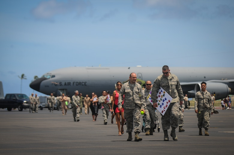 Airmen from the Hawaii Air National Guard's 203rd Air Refueling Squadron return home to Joint Base Pearl Harbor-Hickam, Hawaii, Jun. 16, 2016. More than 50 service members, three KC-135 Stratotankers, flight and maintenance crews, and other support personnel were deployed for four months as part of an Air Expeditionary Force rotation. (U.S. Air National Guard photo by Airman 1st Class Robert Cabuco/released)