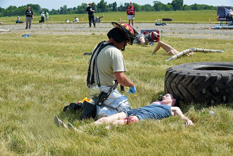 A U.S. Air Force Firefighter, with the 121st Civil Engineering Fire Department, tags an injured passenger according to medical assessment during a full-scale, mass casualty emergency preparedness exercise June 14, 2016 at Rickenbacker International Airport. The exercise was held to test and evaluate emergency response plans of the Columbus Regional Airport Authority, first response emergency services, hospitals, community non-profits and other local emergency preparedness organizations in the event of a major disaster. (U.S. Air National Guard photo by Airman 1st Class Ashley Williams/Released)