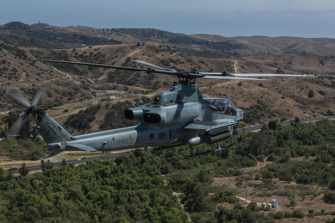 """Marine Light Attack Helicopter Squadron 267 """"Stingers"""" prepares to land aboard Marine Corps Air Station Camp Pendleton, Calif., June 10, 2016. Marines with HMLA-267 supported Marines with 3rd Battalion, 7th Marine Regiment during a close-air-support training mission aboard the combat center."""