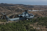 """Marine Light Attack Helicopter Squadron 267 """"Stingers"""" prepares to land aboard Marine Corps Air Station Camp Pendleton, California, June 10, 2016. Marines with HMLA-267 supported Marines with 3rd Battalion, 7th Marine Regiment during a close-air-support training mission aboard the combat center."""