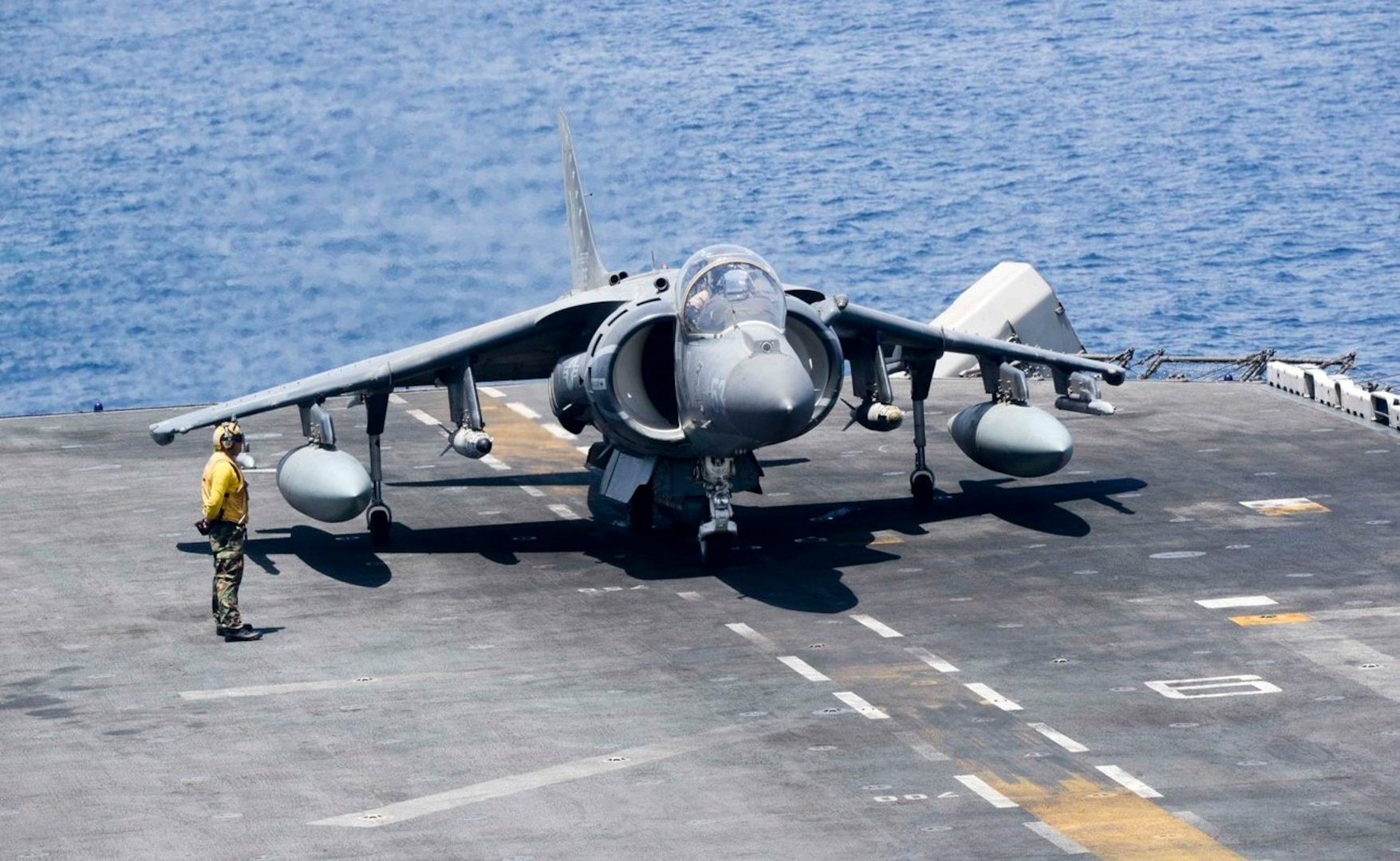 An AV-8B Harrier II, assigned to the 13th Marine Expeditionary Unit (MEU), prepares to launch from the amphibious assault ship USS Boxer (LHD 4) to conduct missions in support of Operation Inherent Resolve.