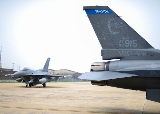 F-16 Fighting Falcons assigned to the Minnesota Air National Guard's 148th Fighter Wing taxi off the runway after a training sortie, June 21, 2016, at Osan Air Base, Republic of Korea. The Airmen and F-16s from the 148th FW deployed to Osan as part of a Theater Security Package for U.S. Pacific Command and Pacific Air Forces. (U.S. Air Force photo by Senior Airman Victor J. Caputo/Released)