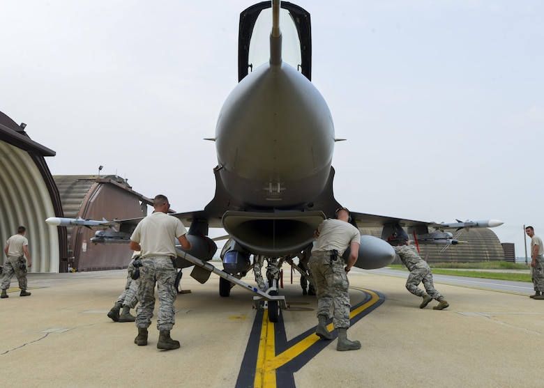 Airmen assigned to the 148th Aircraft Maintenance Unit push an F-16 Fighting Falcon into a hardened aircraft shelter, June 21, 2016, at Osan Air Base, Republic of Korea. The Airmen and F-16s from the Minnesota Air National Guard's 148th Fighter Wing deployed to Osan as part of a Theater Security Package for U.S. Pacific Command and Pacific Air Forces. (U.S. Air Force photo by Senior Airman Victor J. Caputo/Released)