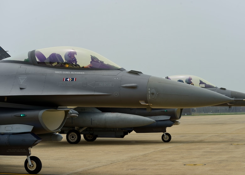 Pilots assigned to the 179th Expeditionary Fighter Squadron wait for their post-flight, end-of-runway inspection before taxing back to their parking areas, June 21, 2016, at Osan Air Base, Republic of Korea. The pilots, who are deployed from the Minnesota Air National Guard's 148th Fighter Wing, landed after successfully completing a training sortie. (U.S. Air Force photo by Senior Airman Victor J. Caputo/Released)