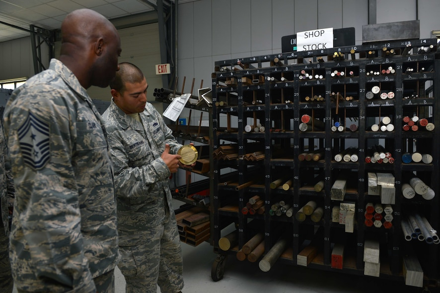 U.S. Air Force Staff Sgt. Steve Bertrand, 39th Maintenance Squadron metals technology craftsman, explains different types of materials to U.S. Air Force Chief Master Sgt. Vegas Clark, 39th Air Base Wing command chief, June 22, 2016, at Incirlik Air Base, Turkey. The rack contains authorized material used for fabrication and repair. (U.S. Air Force photo by Senior Airman John Nieves Camacho/Released)
