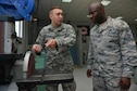 U.S. Air Force Staff Sgt. Justin Beaudean, 39th Maintenance Squadron structural maintenance craftsman, explains equipment operation to U.S. Air Force Chief Master Sgt. Vegas Clark, 39th Air Base Wing command chief, June 22, 2016, at Incirlik Air Base, Turkey. Clark visited the maintenance support flight to expand his knowledge and see the different sections' functions. (U.S. Air Force photo by Senior Airman John Nieves Camacho/Released)