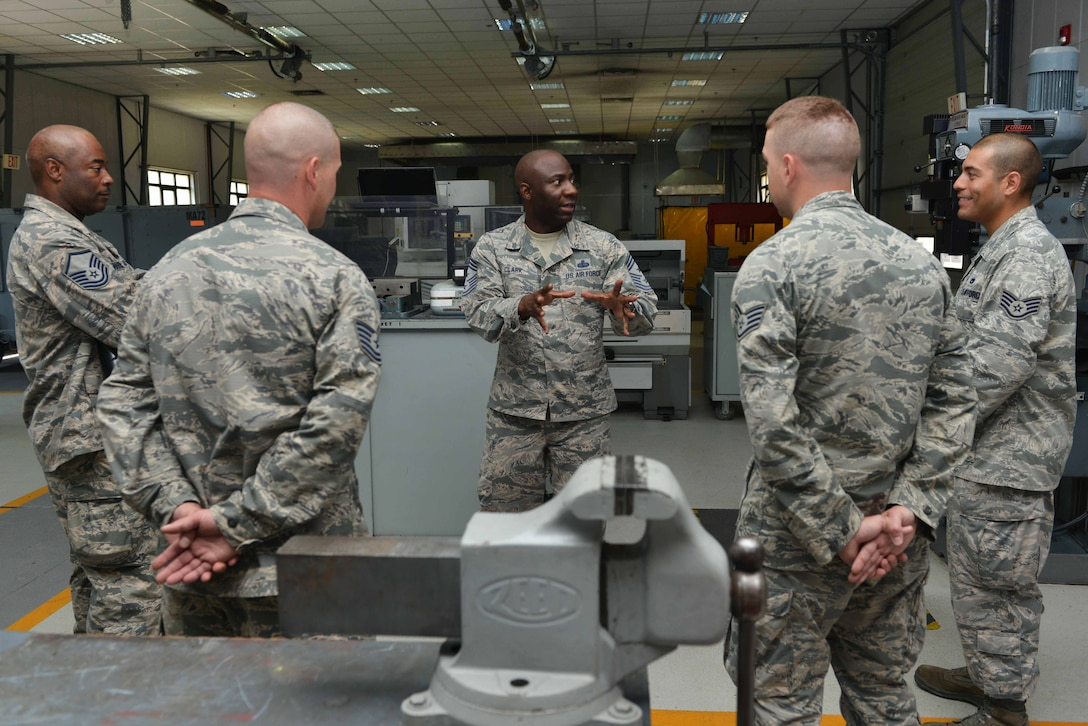U.S. Air Force Chief Master Sgt. Vegas Clark, 39th Air Base Wing command chief, speaks to 39th Maintenance Squadron Airmen June 22, 2016, at Incirlik Air Base, Turkey. Clark visited the 39th MXS to learn more about their daily operations and tasks. (U.S. Air Force photo by Senior Airman John Nieves Camacho/Released)