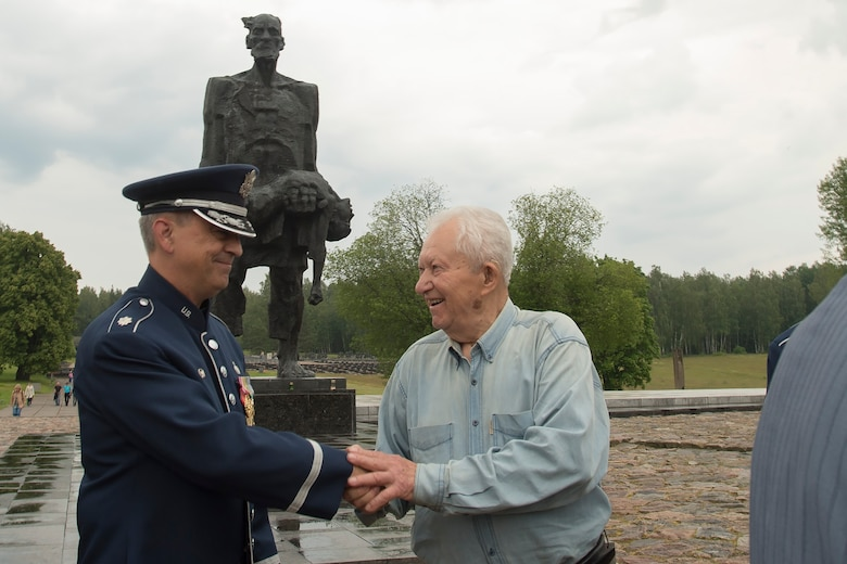 Lt. Col. Mike Mench, U.S. Air Forces in Europe Band commander, talks with Grigory, former air force wing commander for the Soviet Union, June 20, 2016, in Khatyn Memorial, Belarus. Grigory talked with Mench about his service in the military and thanked him for coming to Belarus. While in Belarus, 13 bandsmen performed at events in Minsk and surrounding communities. (U.S. Air Force photo/Technical Sgt. Paul Villanueva II)
