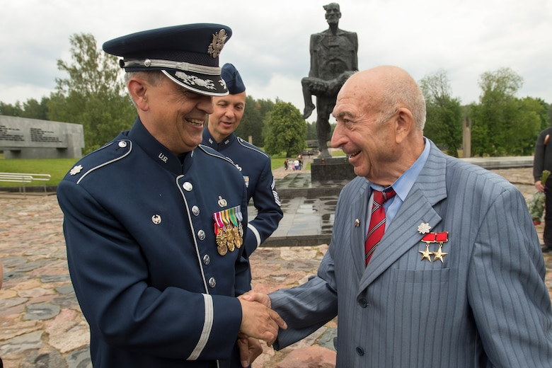 Lt. Col. Mike Mench, U.S. Air Forces in Europe Band commander, talks with Vladimir Yarygin, a former submariner for the Soviet Union, June 20, 2016, in Khatyn Memorial, Belarus. While in Belarus, 13 bandsmen performed in Minsk and surrounding communities to commemorate the alliance that ended the greatest conflict of the 20th Century. The United States, Belarus, and other ally and partner nations continue to remember and honor shared World War II sacrifices. (U.S. Air Force photo/Technical Sgt. Paul Villanueva II)