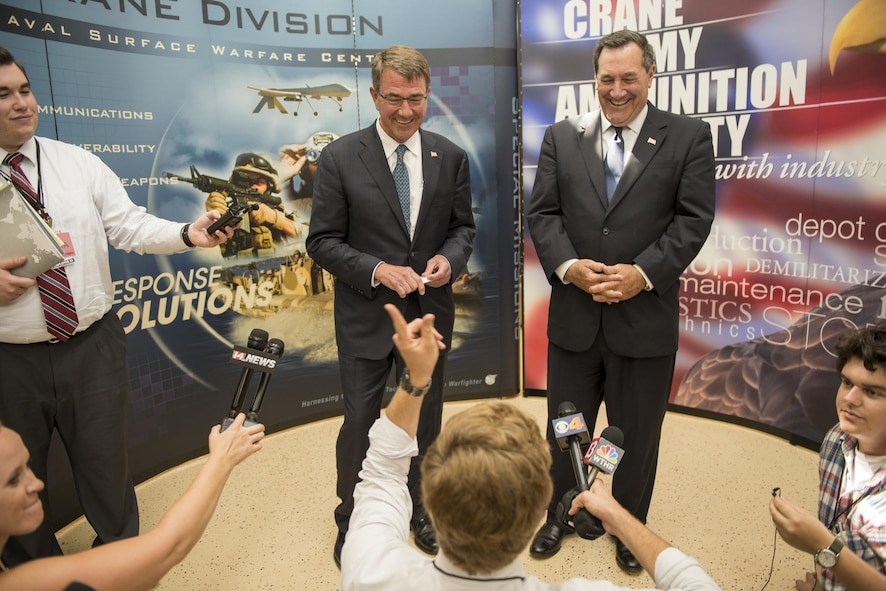Defense Secretary Ash Carter, left, and U.S. Sen. Joe Donnelly of Indiana host a press conference at Naval Surface Warfare Command in Crane, Ind.