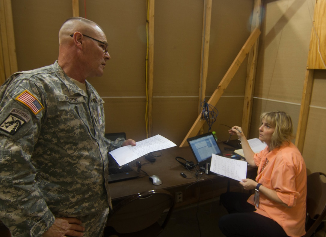 FORT A.P. HILL, Va. - Sgt. Maj. Larry Houston, left, discusses missions with Defense Logistics Agency representative Shona Lawrence at the 2016 Quartermaster Liquid Logistics Exercise, a training exercise in which almost 700 Army Reserve Soldiers of the 745th Quartermaster Group provide fuel and water to military installations. (U.S. Army photo by Spc. Gary R. Yim)