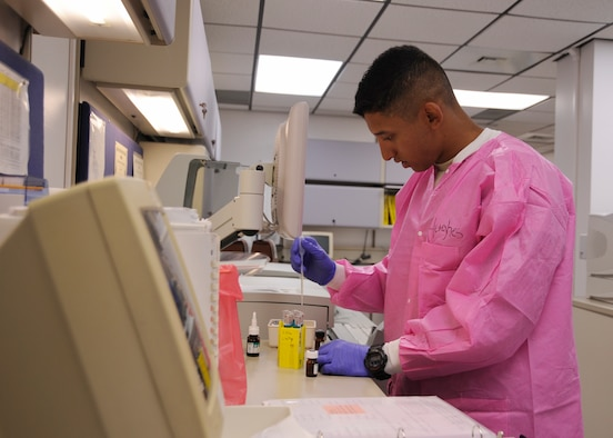 U.S. Air Force Airman 1st Class Jadlow Hughes, 325th Medical Support Squadron laboratory technician, performs tests on glucose levels of a patient in the 325th MDSS laboratory, June 20, 2016. These are known as hemoglobin A1C tests, which reflects the average blood glucose control and is an important measurement for those with diabetes. (U.S. Air Force photo by Senior Airman Solomon Cook/Released)