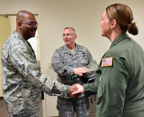 "The new vice commander at the 932nd Airlift Wing, Colonel Esteban ""Esty"" Ramirez, is introduced by Col. Jonathan Philebaum, 932nd Airlift Wing commander (center), to Senior Airman Samantha Strom, an emergency medical technician in the 932nd Aeromedical Evacuation Squadron.  The flying unit takes care of patients in the air on a variety of aircraft, and must be worldwide ready throughout the year.  The 932nd Airlift Wing belongs to 22nd Air Force, under Air Force Reserve Command.   (U.S. Air Force photo by Tech. Sgt. Christopher Parr)"