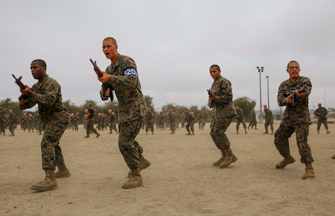 Recruits from India Company, 3rd Recruit Training Battalion, conduct straight thrusts during a modified bayonet assault course at Marine Corps Recruit Depot San Diego, June 21. Recruits were taught different moves during Marine Corps Martial Arts Program classes, learning offensive and defensive techniques used in combat. Annually, more than 17,000 males recruited from the Western Recruiting Region are trained at MCRD San Diego. India Company is scheduled to graduate July 15.