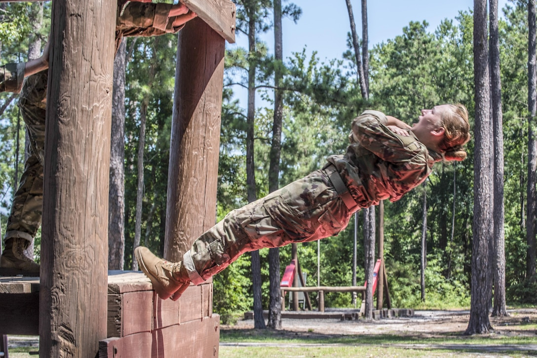 A soldier in basic training falls several feet out of a training obstacle onto a mat during the confidence course at Fort Jackson, S.C., June 22, 2016. Army photo by Sgt. 1st Class Brian Hamilton