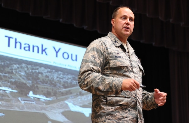 """Col. John Nichols, 14th Flying Training Wing Commander, speaks to Team BLAZE personnel during one of three all-calls June 21 at Columbus Air Force Base, Mississippi. During the all calls, Nichols covered a """"hodgepodge"""" of topics to include the 2016 Strategic Plan, the wing mission, the A-29 mission, the 14th Medical Group's recent inspection, the Green Dot Campaign, DUIs, and a conclusion with questions from the audience. (U.S. Air Force photo/Senior Airman Kaleb Snay)"""