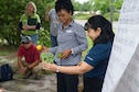 Yolanda Larson, produce manager at the Hurlburt Field commissary, left, and Sandra DeMezzo, a registered dietitian nutritionist with the Health and Wellness Center, show children different fruits and vegetables during a Summer Reading Program event at Hurlburt Field, Fla., June 23, 2016. Week three of the eight-week program focuses on the importance of fruit and vegetable intake as well as physical fitness. (U.S. Air Force photo by Senior Airman Krystal M. Garrett)