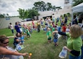 Children sing-along during a fruit and vegetable version of the 'Hokey-Pokey' during a Summer Reading Program event at Hurlburt Field Library, Fla., June 23, 2016. During the event, children participated in physical activities while learning the importance of fruit and vegetable intake. (U.S. Air Force photo by Senior Airman Krystal M. Garrett)