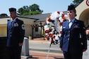 Chief Master Sgt. Derrick Grames, Air Force Life Cycle Management Business and Enterprise Systems Directorate superintendent, and Airman 1st Class Andrea Smith, Barnes Center administration support, present the wreath during the Wreath Laying Ceremony honoring the fallen Airmen of the Khobar Towers attack, June 23, 2016, Maxwell Air Force Base, Ala. Grames represented the highest ranking Airmen who was killed during the attack and Smith was representation of the youngest Airmen who was lost that day. (U.S. Air Force photo/Senior Airman Alexa Culbert)