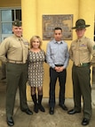 """From left to right: Maj. James Ramsey, Minerva """"Minnie"""" Ramsey, Sgt. Daniel """"D.J."""" Deleon and Sgt. Shaun Kellam pose for a picture after Kellam's graduation from Drill Instructor School at Marine Corps Recruit Depot San Diego, Calif., December 2014. Kellam joined the Marine Corps in 2008, following in the footsteps of Maj. Ramsey. (Courtesy photo/Released)"""