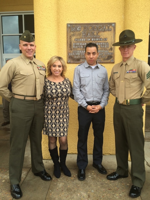 "From left to right: Maj. James Ramsey, Minerva ""Minnie"" Ramsey, Sgt. Daniel ""D.J."" Deleon and Sgt. Shaun Kellam pose for a picture after Kellam's graduation from Drill Instructor School at Marine Corps Recruit Depot San Diego, Calif., December 2014. Kellam joined the Marine Corps in 2008, following in the footsteps of Maj. Ramsey. (Courtesy photo/Released)"