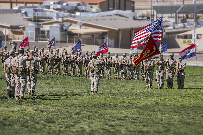 Marine Wing Support Squadron 374 salutes the U.S. national colors during the unit's change of command at Lance Cpl. Torrey L. Gray Field, June 17, 2016. During the change of command, Lt. Col. Steven Murphy relinquished command of MWSS 374 to Lt. Col. Christopher Siler. (Official Marine Corps photo by Cpl. Thomas Mudd/Released)
