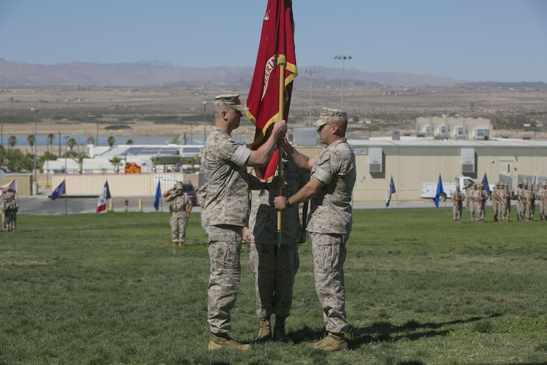 Lt. Col. Steven Murphy, right, transfers the Marine Wing Support Squadron 374 colors to Lt. Col. Christopher Siler, left, during the unit's change of command at Lance Cpl. Torrey L. Gray Field, June 17, 2016. (Official Marine Corps photo by Cpl. Thomas Mudd/Released)
