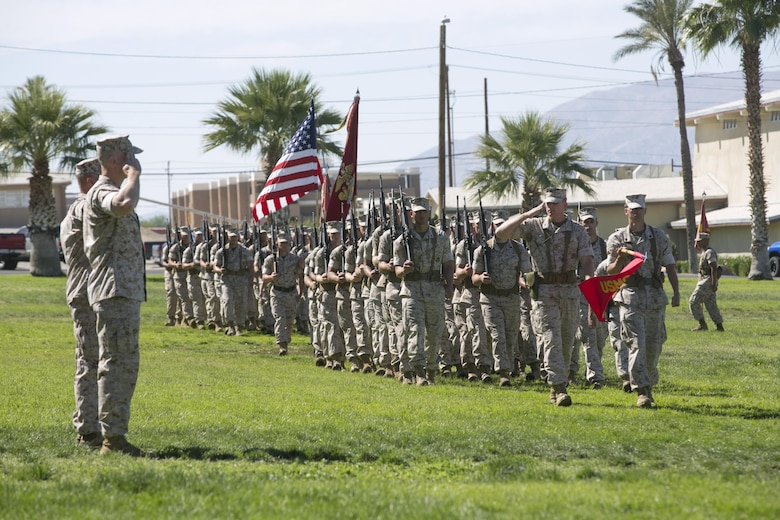 Lt. Col. Christopher Siler, on-coming commanding officer, and Lt. Col. Steven Murphy, outgoing commanding officer, Marine Wing Support Squadron 374, conduct a pass-in-review during the unit's change of command at Lance Cpl. Torrey L. Gray Field, June 17, 2016. (Official Marine Corps photo by Cpl. Thomas Mudd/Released)