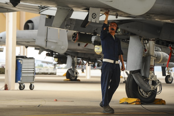 U.S. Air Force Senior Airman Andy Bui, 355th Aircraft Maintenance Squadron A-10C Thunderbolt II crew chief, closes a snap panel of an A-10 on the flightline at Davis-Monthan Air Force Base, Ariz., June 23, 2016. The 355th AMXS provides safe and properly configured aircraft in order to meet mission requirements for three squadrons. (U.S. Air Force photo by Airman 1st Class Mya M. Crosby/Released)