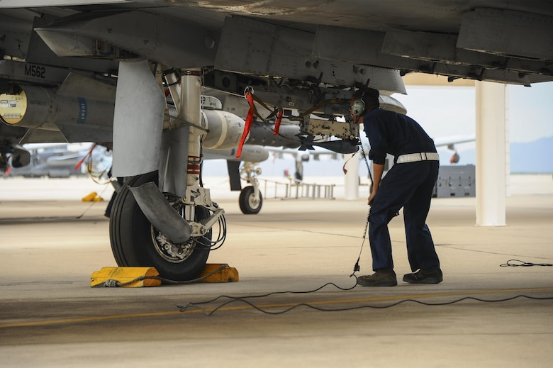 U.S. Air Force Senior Airman Andy Bui, 355th Aircraft Maintenance Squadron A-10C Thunderbolt II crew chief, performs an operational check on the flightline at Davis-Monthan Air Force Base, Ariz., June 23, 2016. The 355th AMXS develops and executes scheduled maintenance and provides forces to support worldwide contingency tasking. (U.S. Air Force photo by Airman 1st Class Mya M. Crosby/Released)