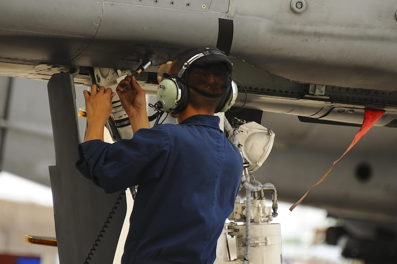 U.S. Air Force Senior Airman Andy Bui, 355th Aircraft Maintenance Squadron A-10C Thunderbolt II crew chief, performs an operational check on the flightline at Davis-Monthan Air Force Base, Ariz., June 23, 2016. The checklists are designed to ensure the safety of the aircraft and the pilot before takeoff. (U.S. Air Force photo by Airman 1st Class Mya M. Crosby/Released)