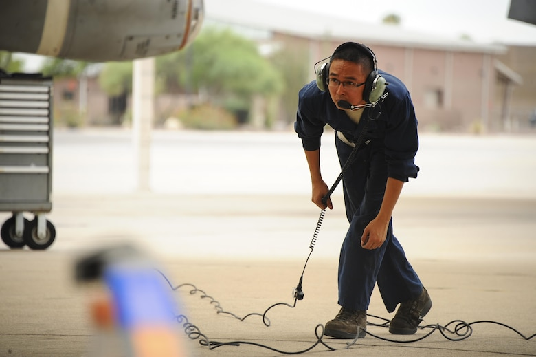 U.S. Air Force Senior Airman Andy Bui, 355th Aircraft Maintenance Squadron A-10C Thunderbolt II crew chief, inspects an A-10 on the flightline before takeoff at Davis-Monthan Air Force Base, Ariz., June 23, 2016. The 355th AMXS generates all combat and training sorties in the 355th Fighter Wing and manages the efforts of 500 Airmen in 10 specialties maintaining A-10C attack aircraft. (U.S. Air Force photo by Airman 1st Class Mya M. Crosby/Released)