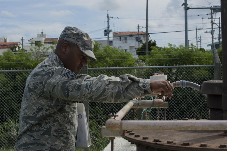 U.S. Air Force Tech. Sgt. Camarius Johnson, 18th Logistics Readiness Squadron fuels quality assurance evaluator, performs an organizational tank inspection June 21, 2016, at Kadena Air Base, Japan. Part of the inspection includes checking movement of all valves and prevention of rust formation. (U.S. Air Force photo by Airman 1st Class Lynette M. Rolen)