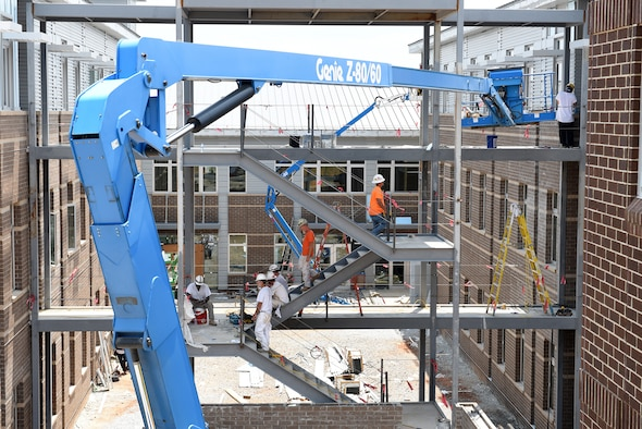 Workers ascend and descend the breezeway staircase structure between the two dormitory buildings under construction, June 23, 2016 at the I.G. Brown Training and Education Center in Louisville, Tenn. Ladders and lifts (six in all) add to the building site's complexity, with the inner courtyard, and further still, the classroom building in the background. The facility will contain approximately 47,000 square feet of additional space on three levels and two levels with ten 20-person and two 100-person classrooms. (U.S. Air National Guard photo by Master Sgt. Mike R. Smith/Released)