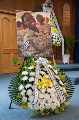 A photo of Staff Sgt. Cierra Rogers and wreath sit at the front of the base chapel during her memorial service at Osan Air Base, Republic of Korea, June 24, 2016.  Military and civilian members of the Osan and Pyeongtaek community gathered alongside the Rogers family to honor Sergeant Rogers, a 731st Air Mobility Squadron Airman, who died May 20. (U.S. Air Force photo by Staff Sgt. Jonathan Steffen)