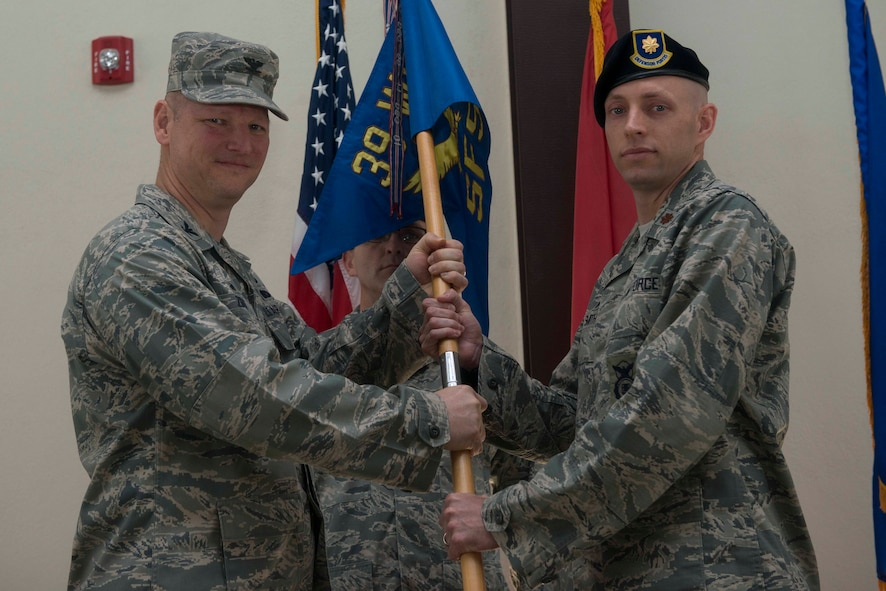 U.S. Air Force Maj. William Smith, 39th Security Forces Squadron incoming commander, receives command from U.S. Air Force Col. James, Zirkel, 39th Weapons System Security Group commander, June 24, 2016, at Incirlik Air Base, Turkey. Prior to taking command, Smith attended the Naval War College in Newport, R.I., where he completed an intermediate level program. (U.S. Air Force photo by Senior Airman John Nieves Camacho/Released)