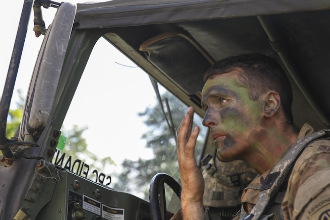 Army Capt. Scott Hasenpflug applies camouflage paint before a tactical operation during Swift Response 16 at the Hohenfels Training Area in Hohenfels, Germany, Jun. 22, 2016. The military crisis response training event includes multinational airborne forces. Army photo by Pfc. Rachel Wilridge