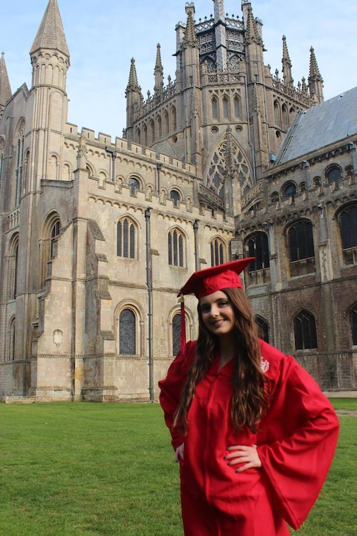 Lakenheath High School senior, Laci Clark, poses in front of Ely Cathedral following her graduation ceremony at Ely, England, June 10, 2016. Graduating students approached their final days at LHS with much anticipation and excitement for the future. (Courtesy photo)
