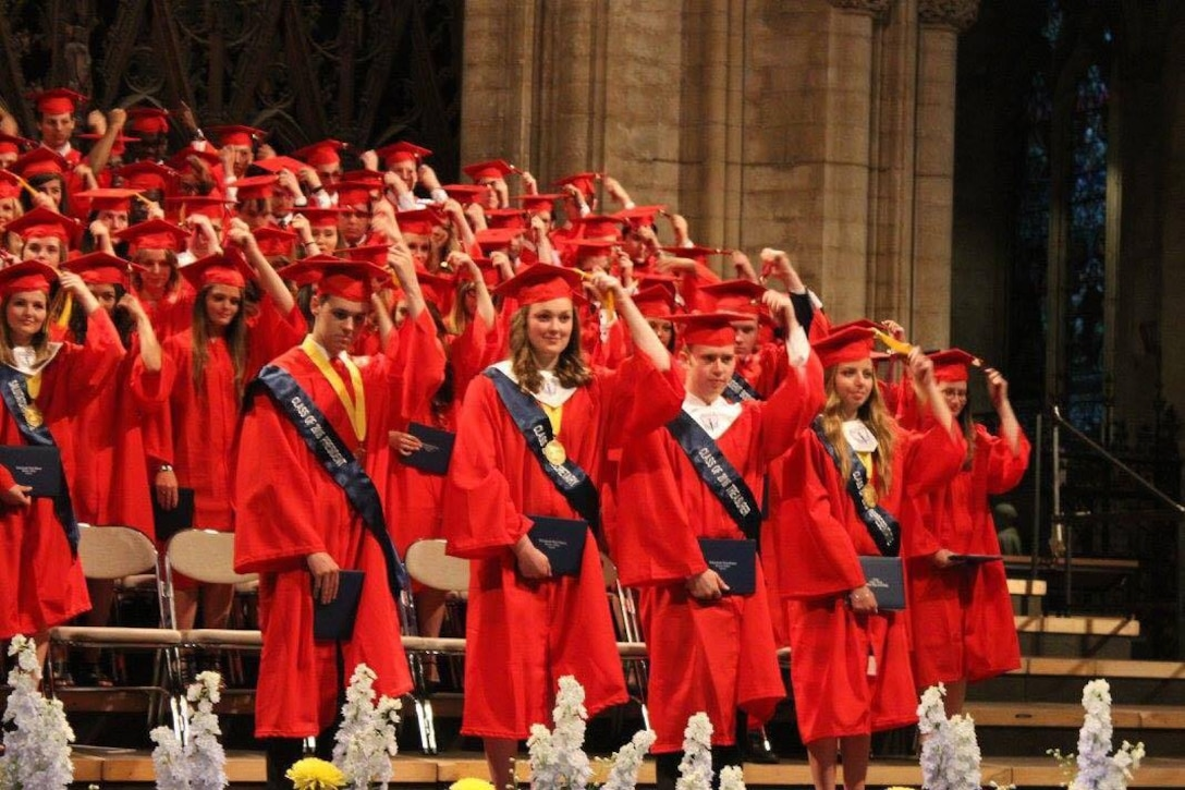 Lakenheath High School senior students adjust their tassels to signify the end of their high school careers at Ely Cathedral at Ely, England, June 10, 2016. Graduating students approached their final days at LHS with much anticipation and excitement for the future. (Courtesy photo)
