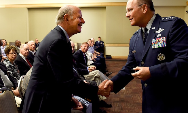 Lt. Gen. James Jackson (right), chief of Air Force Reserve, presents a Vietnam War veteran with a pin during a ceremony at the Pentagon, Washington, D.C., June 21, 2016. More than 10 veterans were recognized during the ceremony. (U.S. Air Force photo by Staff Sgt. Alyssa C. Gibson/Release)