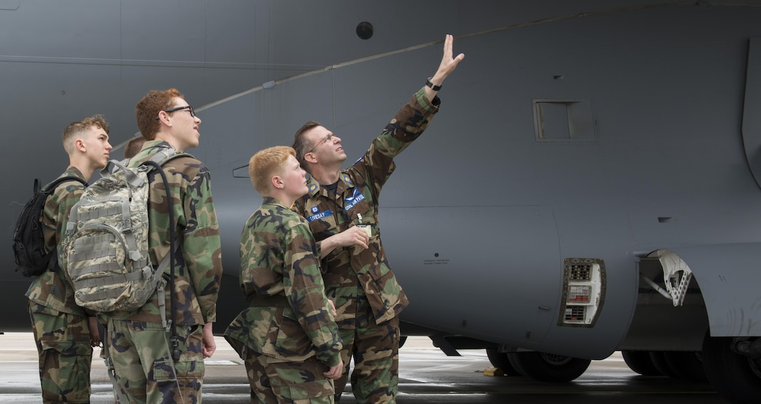 Maj. Michael Livesay, Ramstein Civil Air Patrol squadron commander, tells CAP cadets about the engines in a C-17A Globemaster III aircraft during a tour June 21, 2016, at Ramstein Air Base, Germany. CAP included cadets from Ramstein, Spangdalem Air Base, Germany and Mildenhall Air Base, England. They toured Ramstein from June 18 to 24, and visited squadrons associated with all three wings on base to get a glimpse of what life is like as an Airman. (U.S. Air Force photo/Airman 1st Class Tryphena Mayhugh)